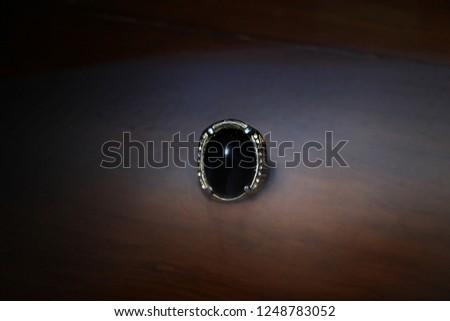 black shiny gemstone #1248783052