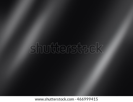 Black shiny metal plate dark background