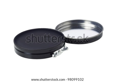 Black Shoe Polish in Open Flat Round Container White Background