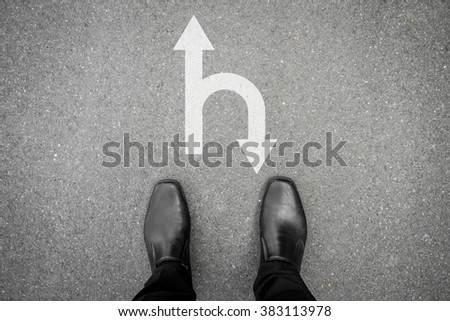 black shoes standing at the crossroad and has decision to make - move forward or u turn and go backward