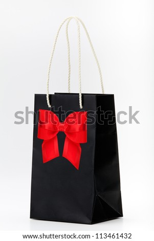 Black shopping bag with red bow  on white