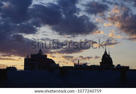 Black silhouette buildings with roof. Kiev, Kyiv, Ukraine. Blue hour, blue clouds on sunset time #1077260759