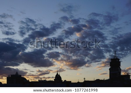 Black silhouette buildings with roof. Kiev, Kyiv, Ukraine. Blue hour, blue clouds on sunset time #1077261998