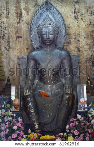 black sitting buddha statue in the temple at Ayuttaya province, Thailand. This is very old buddha statue.