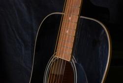 black six string acoustic guitar