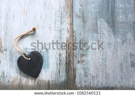 Black slate heart on vintage background for a mothers day card top view #1082560121