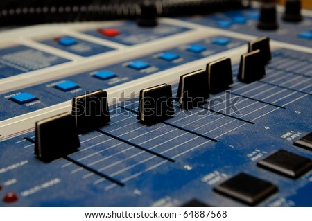 Black sliders on dj console