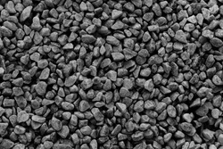 Black small road stone background,  dark gravel pebbles stone texture seamless texture, granite,marble