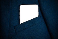 Black smartphone with white screen in men suit pocket close up. Copy space, mockup