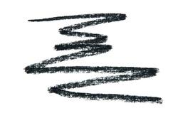 Black smear of crushed eyeliner or acrylic paint isolated on a white background. - Image