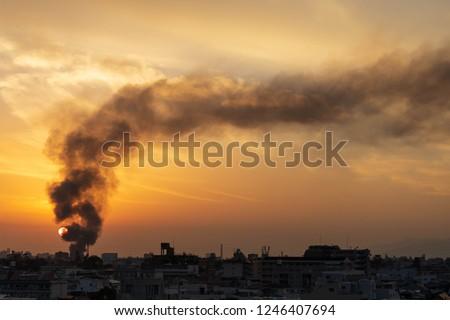 Black smoke from structure fire in Osaka neighborhood billows into setting sun