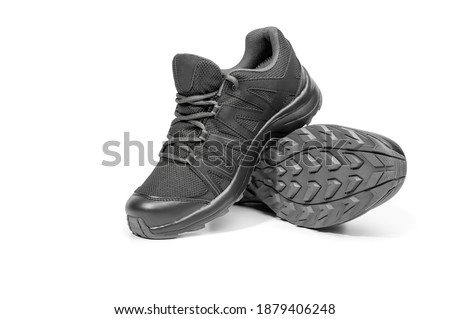 black sneakers isolated on white background. Black sneakers running shoes. Casual shoes. Youth style. Shoes for trekking, running, hikking. New black sport shoes. Heavy-duty tread outsole ストックフォト ©