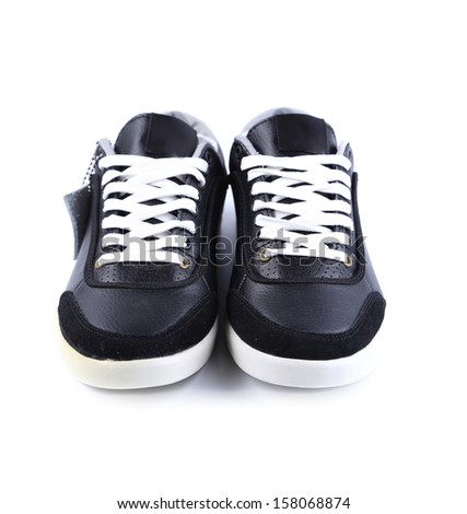 Black sneakers with white laces. Isolated on a white background.