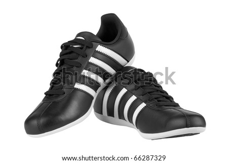 Black sneakers with white strips isolated on white background