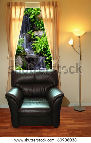 black sofa and lamp in front of waterfall