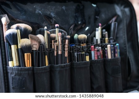 black soft case with a set of makeup #1435889048