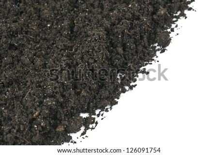 black soil as background on white