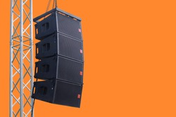 Black speaker hanging on a stand / Sound System in concert. Clipping path.