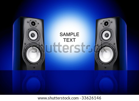 Black speakers on blue background. - stock photo