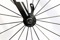 Black Spokes and carbon fork of the road bike. Parts of bicycle.