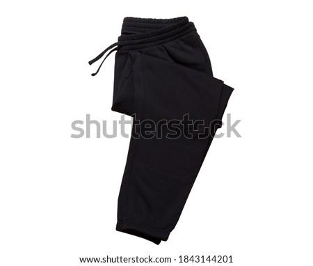 Black  Sport Sweatpants Isolated on White Background. Folded black pants Stock photo ©
