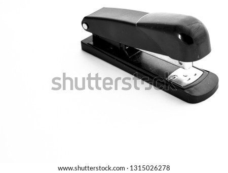 Black stapler isolated on white background