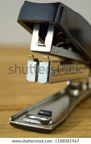 Black Stapler on the table close up Shallow Depth of Field