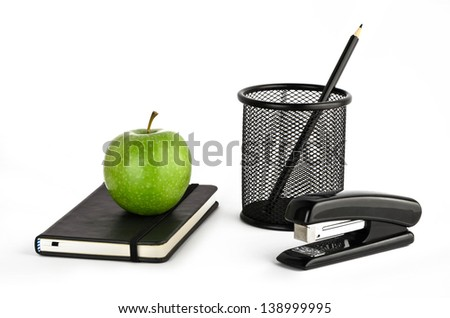 Black stationery with green apple on a white background