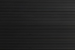 black steel shutter door. grunge black metal foldable door background and texture.