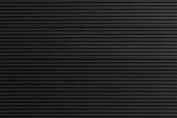 black steel shutter door. grunge black metal foldable door background and texture.