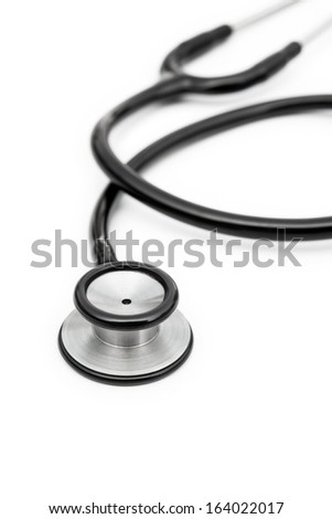 black stethoscope on a white background vertical