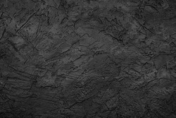 Black stone background texture. Black stone plaster cement. Grunge wall. Graphite