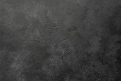 Black stone or slate background or texture, horizontal