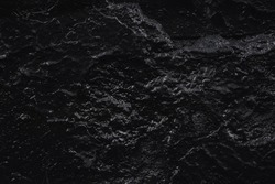 Black Stone texture for designers. Wall abstraction. Mysterious stranger space. Paint spots. Rock surface with cracks. Abstract texture. Dark Background. Rock texture. Stone Background