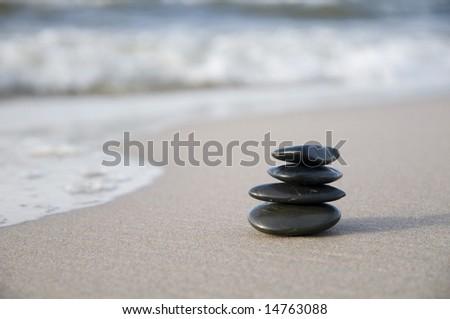 Black stones on the beach.