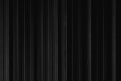 Black strip line metal sheet container wall texture for background.