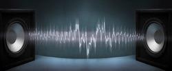 Black subwoofer speaker car audio music system on orange background