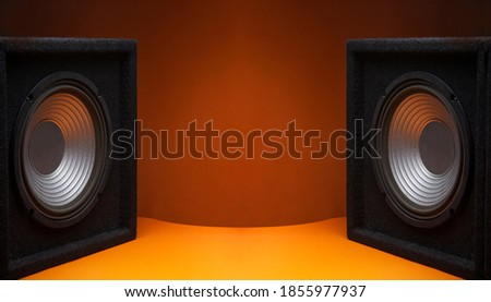 Black subwoofer speaker car audio music system on orange background Сток-фото ©