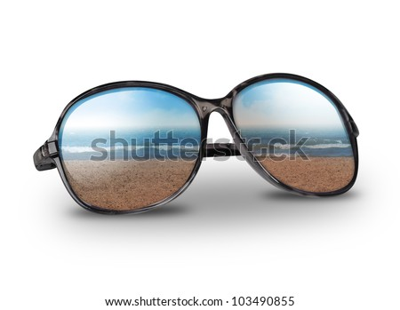 Black sun glasses have a beach with sand reflecting on an isolated white background. Use it for a vacation or summer concept.