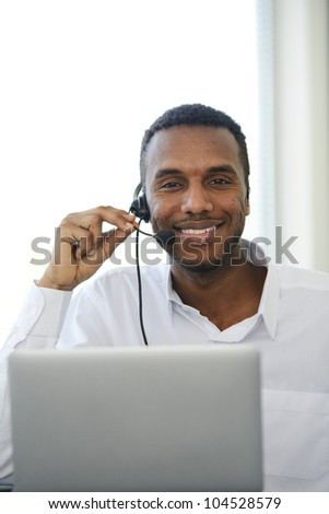 Black support phone smiling operator at workplace