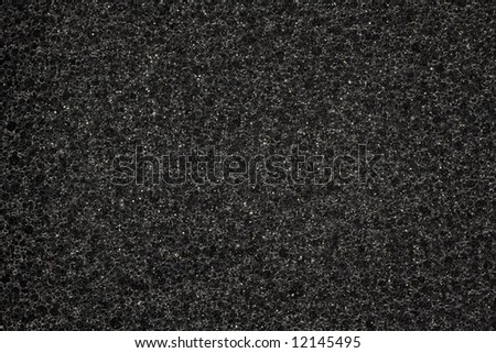 Black synthetic foam texture - stock photo