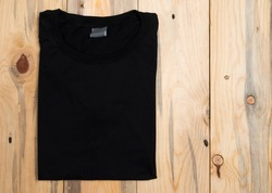 Black t-shirt on a wooden background