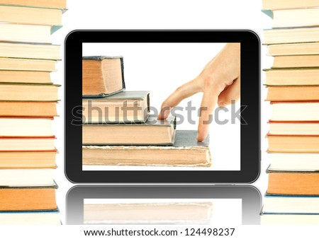 Black tablet and books around. Fingers go up on the books in tablet. Concept of growth up when you reading books