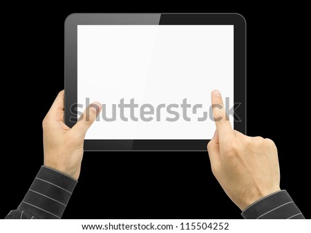 Black tablet pc in hands over black background.