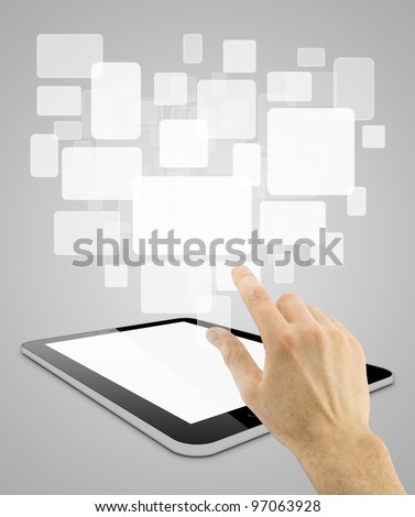 Black tablet pc on grey background, with hand choosing abstract cards