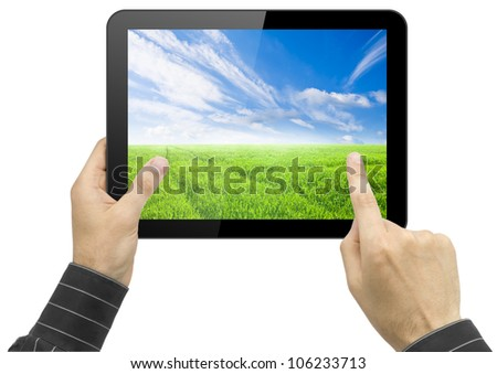 Black tablet pc with nature wallpaper in hands on white background. Portable computer