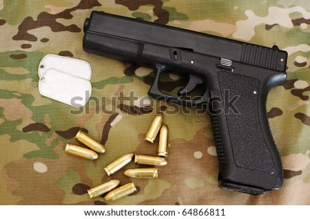 Black tactical pistol and rounds
