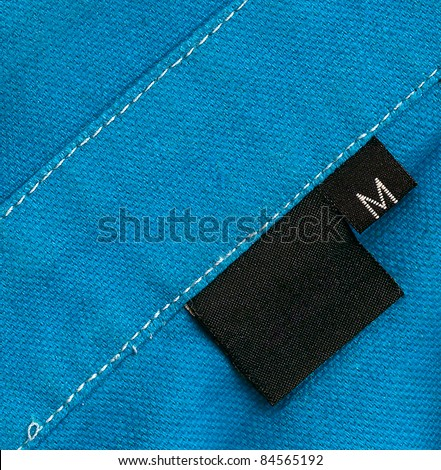 Black tag on blue a cotton textile
