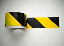 Black tape with a yellow film of a forbidding color on a white isolate