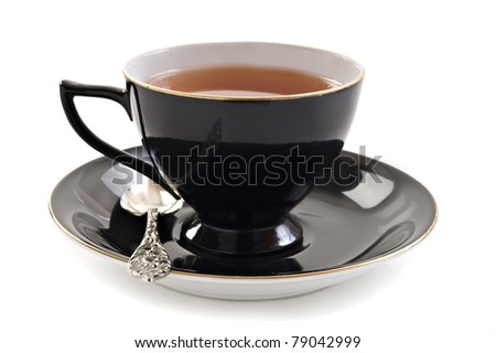 Black tea cup on a white background with space for text